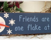 Friends are made one flake at a time primitive wood snowman sign