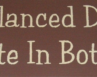 A balanced diet is chocolate in both hands primitive wood sign