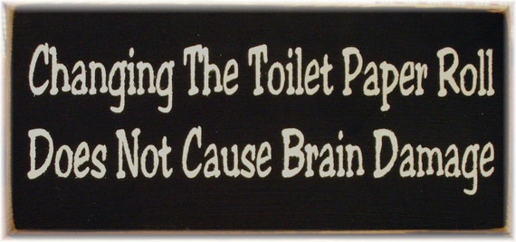 Changing the toilet paper roll does not cause brain damage primitive wood sign