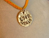 Love Heals - Brass Pendant, it comes with your choice of chain