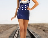 Royal Blue latex/rubber sailor dress with white ruffles and lace up back detail