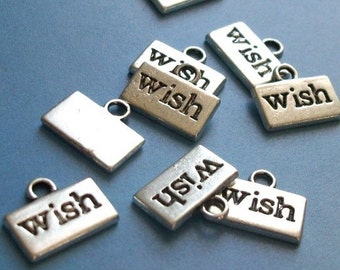 40 'wish' charms, silver tone, 13mm