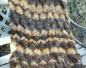 Earth Accents Blanket/Throw in darker to lighter shades of warm brown, in fir cone lace pattern for home decor
