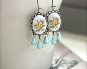 A Vintage Yellow Flower Bouquet Glass Cab, Antiqued Brass Lacy, Opaque Blue Glass Drops Earrings. Summer. Gifts for Her.