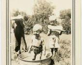 1920s Kids Cool Off with Watermelon and a Dip in a Metal Tub - snapshot 269