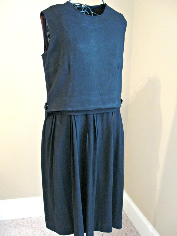 VIntage 1960 dress. Black, sleeveless with pleated skirt. Fair condition, costume, theater, museum, display. Size 38 Bust.