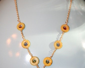Hand made semi precious stones on a Gold Necklace with sponge coral