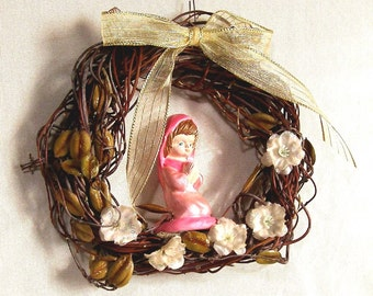 SMALL GIRL KNEELING ceramic-wallhanger wreath  by mawaggie