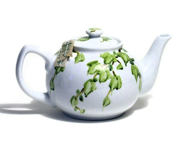 Painted cottage teapot by Laurie Rohner