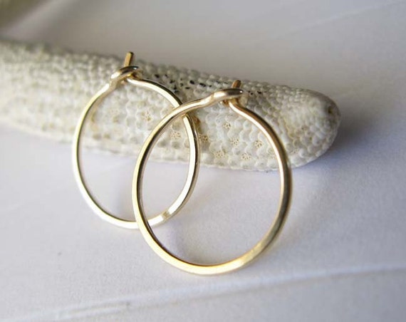 Dainty 14k gold filled tiny 1/2 inch hoops. Artisan handmade. Contemporary. Modern. Minimalist. Jewelry.  Simple everyday small earrings.