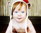 newborn to 12-24 month tan monkey beanie with earflaps and a red flower