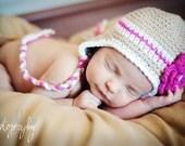 Newborn size tan beanie with hot pink stripe