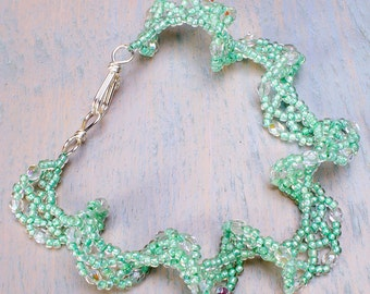 Pale green bracelet, lacy look with Sterling silver clasp.