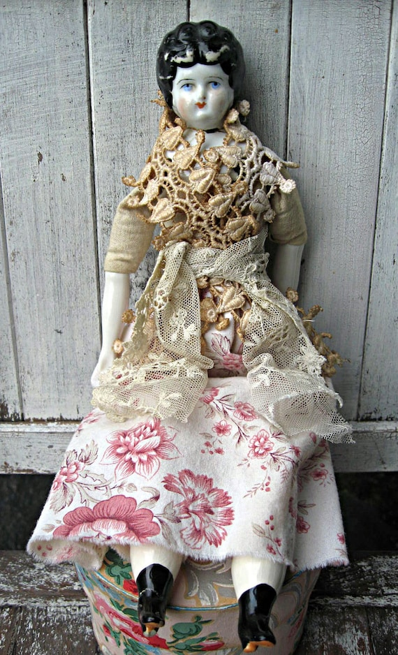 Vintage porcelain German doll, low brow, very pretty