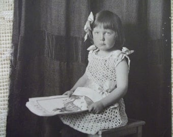 Pretty Little Girl in Crocheted Dress and Holding Scrapbook - Real Photo Postcard - early 1900's