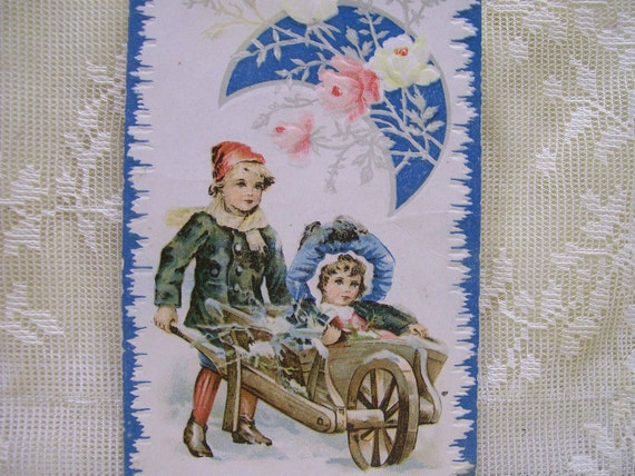 Boy pushing Girl in Wheelbarrow - Crescent Moon - Colorful Embossed Reward of Merit Card - early 1900's