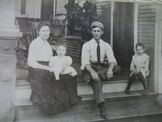 Family Sitting on the Front Porch Steps - Real Photo Postcard - early 1900's