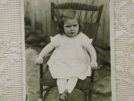 Ornery Little Girl in Wicker Rocking Chair - Real Photo Postcard - early 1900's