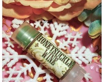 natural lip embellishment - honeysuckle wine - honeysuckle and nectarine flavored lip balm / lip embellishment in nifty frosted dispenser
