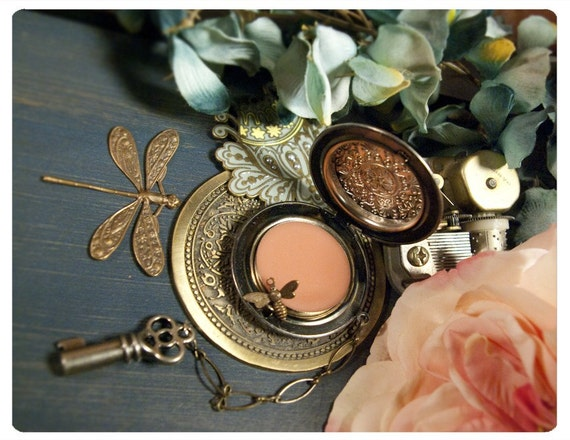 solid perfume in victorian locket: the morrigans charm - artisan made dastardly delightful natural perfumes