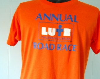 Vintage Road Race Tshirt Lutz 80s Orange Childrens Museum Tee Super Soft and Thin LARGE