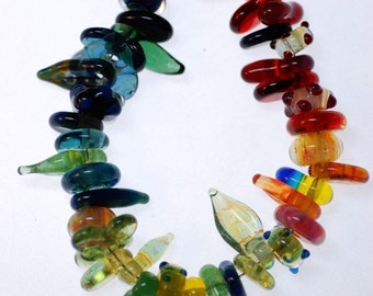 handmade lampwork boro beads in rainbow colors and assorted shapes pkg 15
