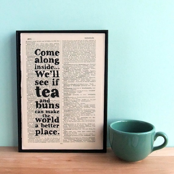 tea and buns wall art on vintage book paper