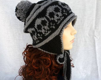 Earflap pom-pom hat with Skulls