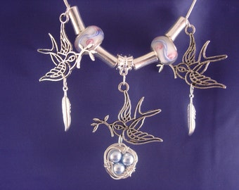 Wire wrapped Lampwork Bird and Nest Pendant Necklace