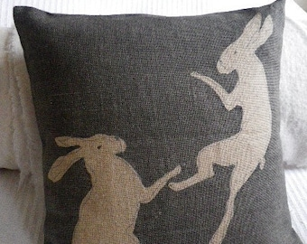 hand printed tumbling hares cushion cover