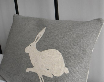 Handprinted pale  grey little running hare cushion