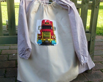 Kids craft apron. Child's school art smock for boy age 9 to 12. Truck.