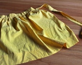 cheerful yellow vintage apron with little white polka dots