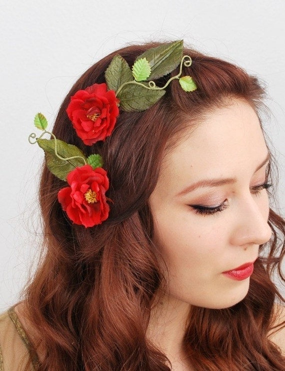 These red rose hair clips will add class to any outfit. The 2 flowers are attached to a hairdresser style clip and has glitter edging. Simply slide into hair for a secure fit.