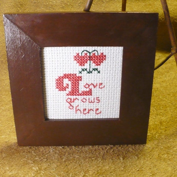 Love Grows Here Hand Stitched Framed Counted Cross Stitch Saying