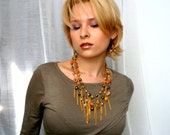 Gold Lava Statement Necklace a stunning blend of various gemstone beads and crystals wrapped in cascades of golden chains