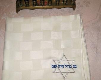 Four 19-inch ecru napkins embroidered for Hanukkah