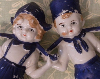 Vintage Dutch boy and Dutch girl statues, figurines. Old, chippy, strawberry blonde mid century charmers, made in JAPAN