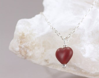 red heart necklace . cinnamon