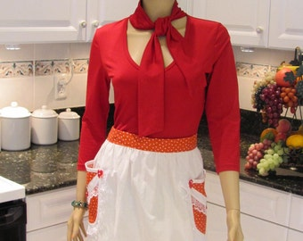 Red and white pol with red and white polka dot trim, can fit larger sized women