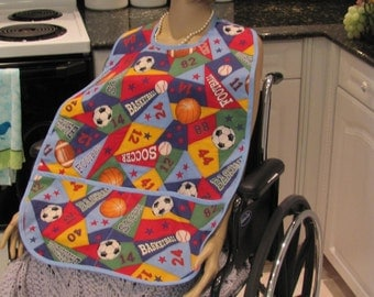 ADULT BIB: unisex, bib/ cover-up , special needs item, baseball print , with pocket,extra large, for the special needs individual