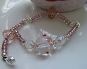 Think PINK glass lampwork focal bead bracelet with lobster clasp