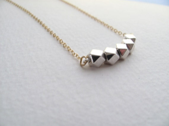 Silver and gold geometric necklace with silver faceted beads, mixed metal