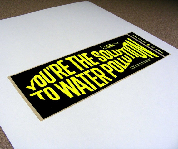 You're the solution to water pollution, vintage bumper sticker, day glo yellow, black, fish shaped text, fishing, water conservation