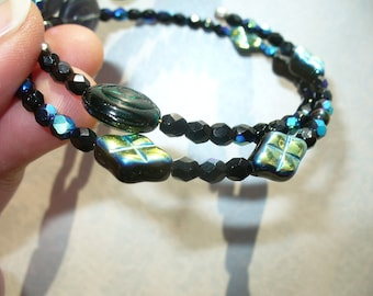 Iridescent aurora borealis black and silver shell double wrap bracelet on memory wire.
