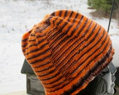bright orange and black striped hat with subtle maine motif