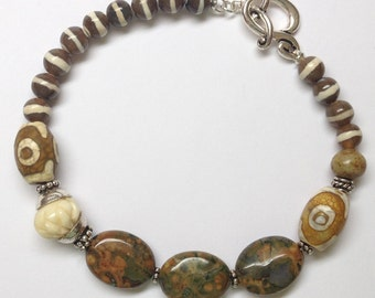 Carved Bone Bracelet with Striped Agate and Oval Rhyolite: Trip to Africa