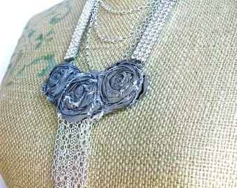Raining Rhinestones- long modern necklace with Vintage rhinestone panels, and hand turned tattered roses