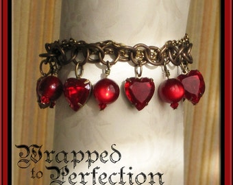 Red Heart Charm Bracelet / Sweetheart Romantic Valentine Anniversary Ruby Rouge Crimson / Antique Brass Swarovski Crystals