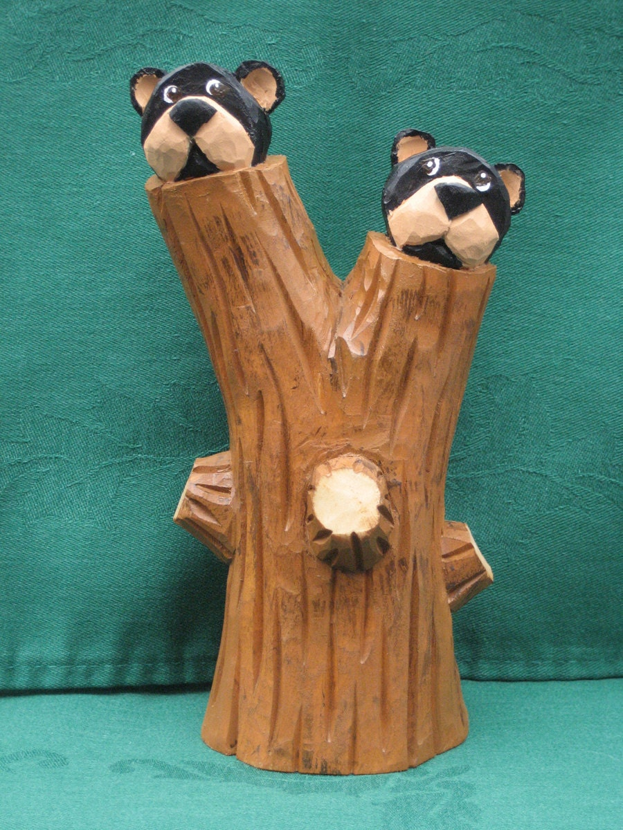 Hand carved handmade bear cubs in tree stump wood carving